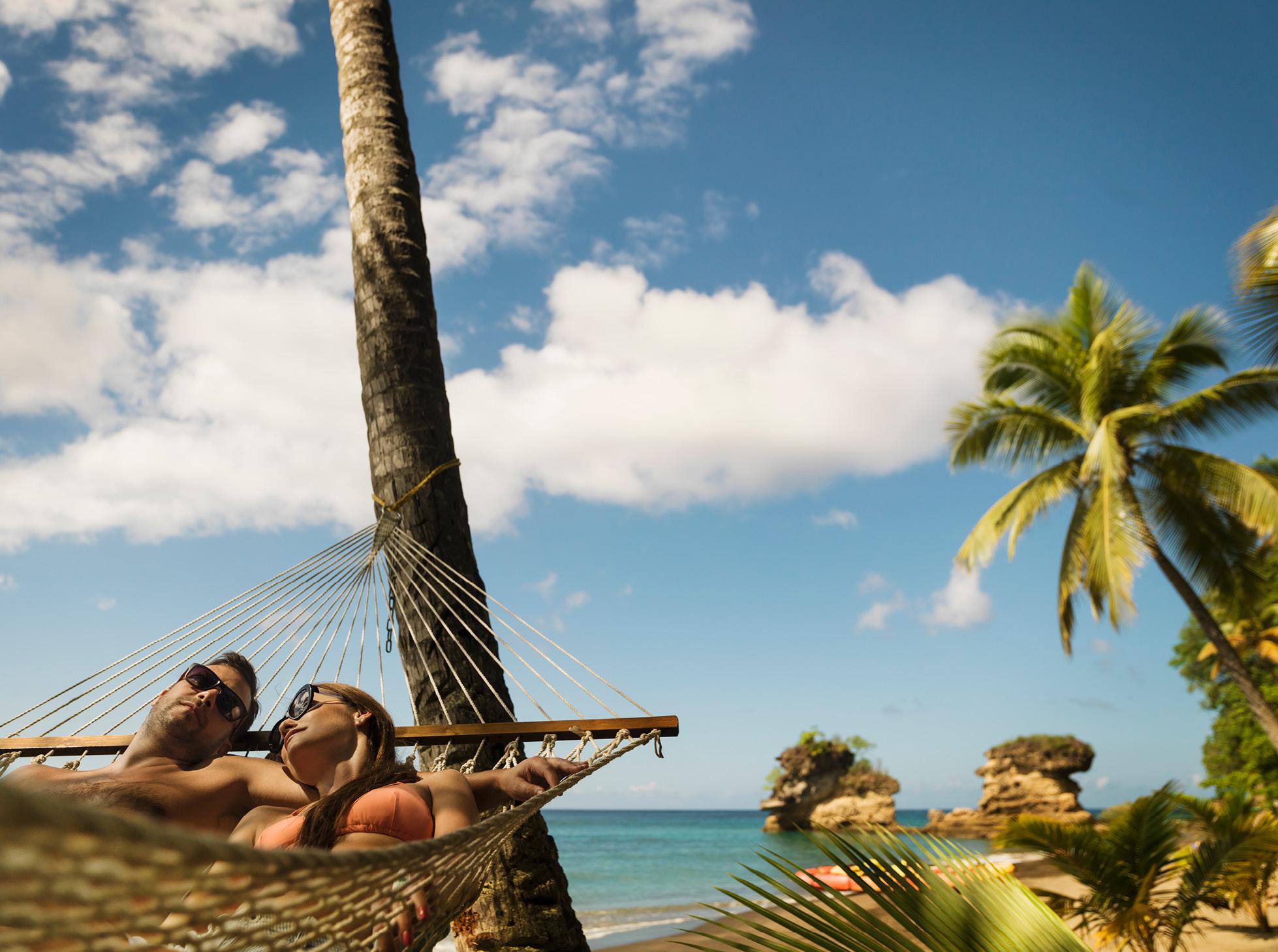 saint lucia romantic couple hammock beach
