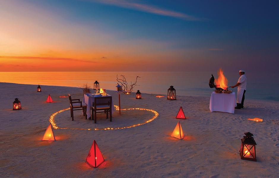 private sunset beach dinner baros maldives