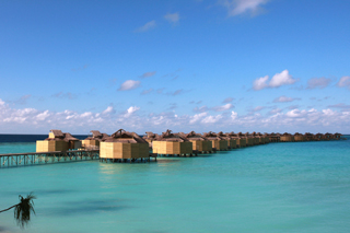 jetty view to the water villas at six senses, laamu, maldives