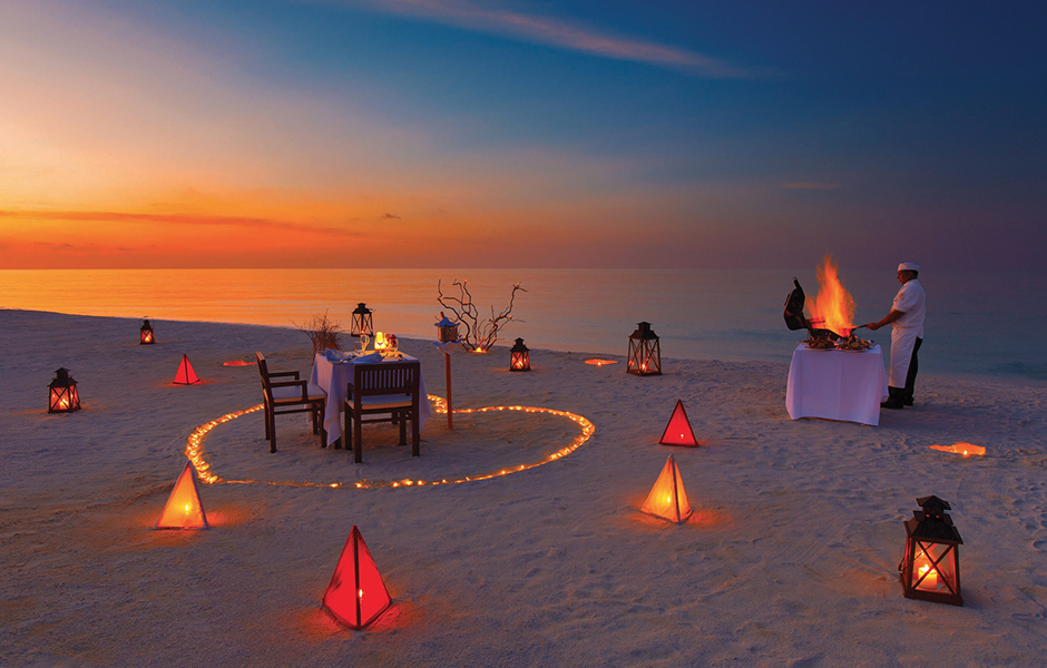 private sunset beach dinner baros maldives
